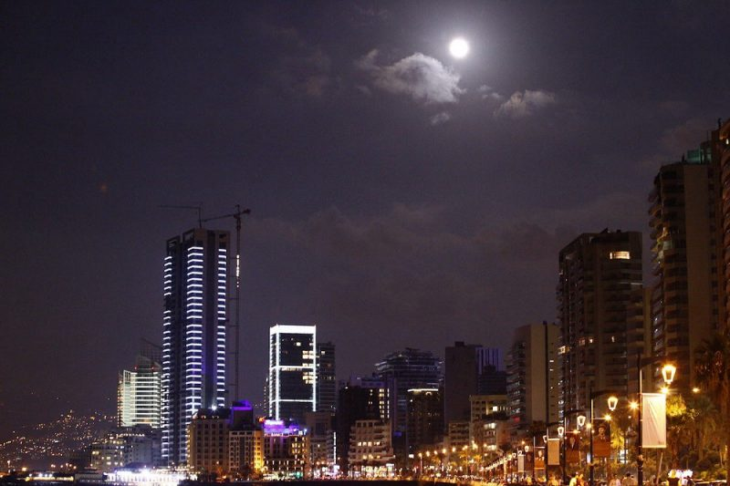 Light of full moon mixing with the city lights of Beirut